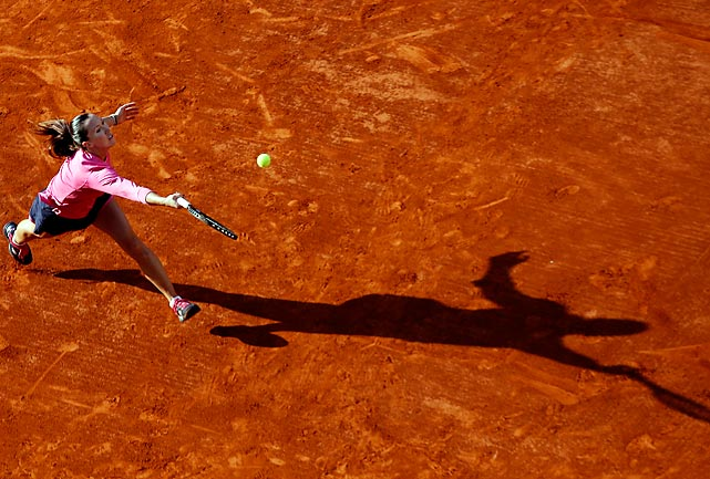 Serbia's Jelena Jankovic stretches, along with her shadow, to return a ball against Australia's Samantha Stosur in their third round match in the French Open.