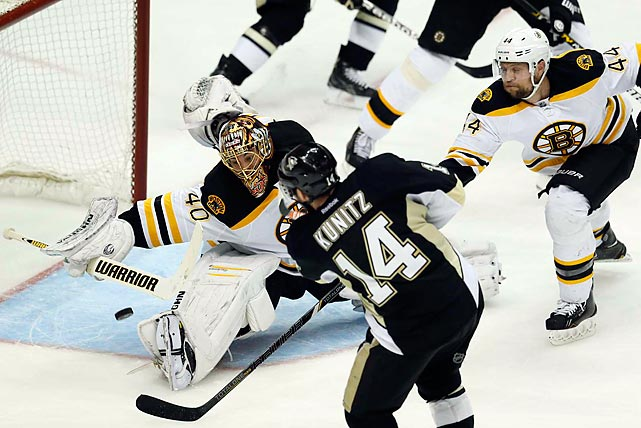 Goaltender Tuukka Rask deflects a shot from Pittsburgh's Chris Kunitz to preserve the shutout in Boston's 3-0 win to open their Conference Finals series against the Penguins on June 1.