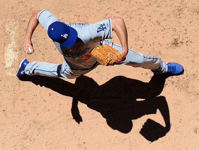 Matt Magill throws a warmup pitch in the Denver sun before the Dodgers' 7-2 loss to the Rockies on June 2.