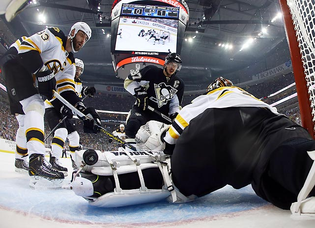 Tuukka Rask gets low to preserve the Bruins' clean sheet against Pittsburgh's Sidney Crosby in Saturday's 3-0 Conference Finals opener.