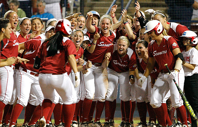 Oklahoma celebrates Lauren Chamberlain's home run during their 6-2 victory over Washington.
