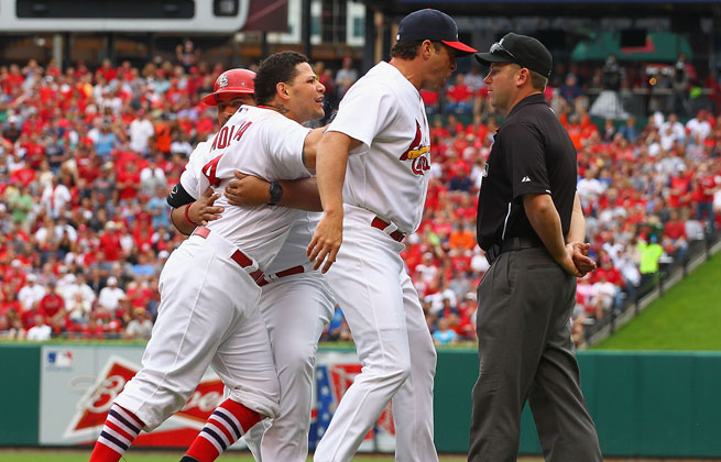 Yadier Molina (left) was suspended one game and fined for bumping umpire Mike Everitt during an argument Sunday.