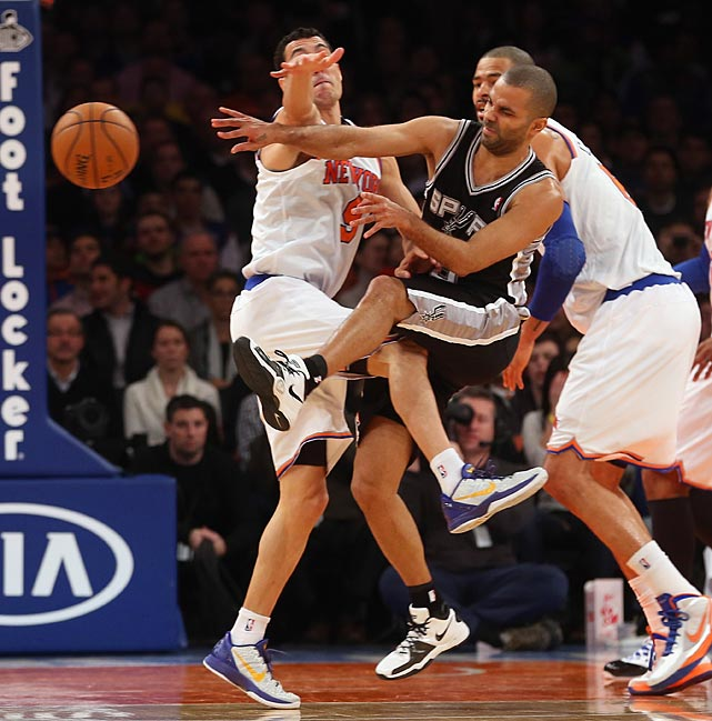 Pablo Prigioni of the Knicks collides with Parker during a game at Madison Square Garden in January.