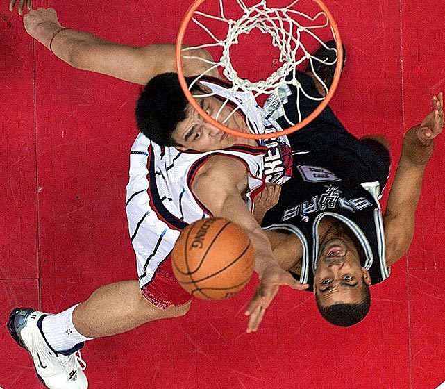 Yao Ming of the Houston Rockets pulls a rebound away from Parker.