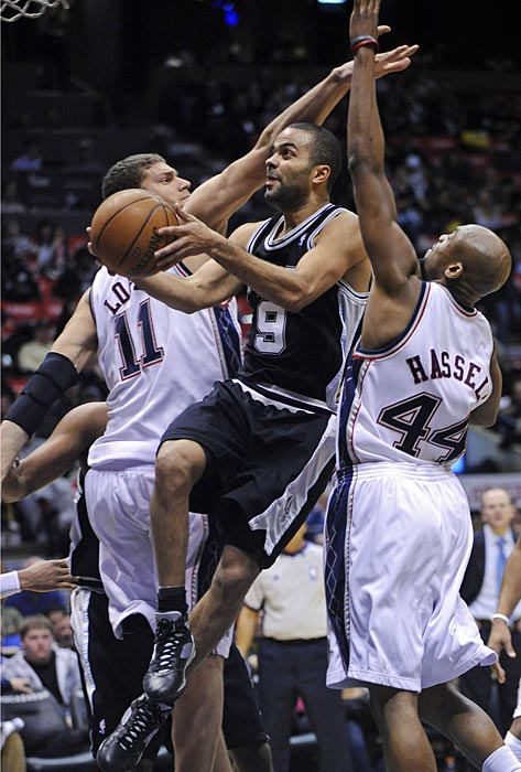 Parker goes up between New Jersey Nets' Brook Lopez, left, and Trenton Hassell during a February game in East Rutherford, N.J.
