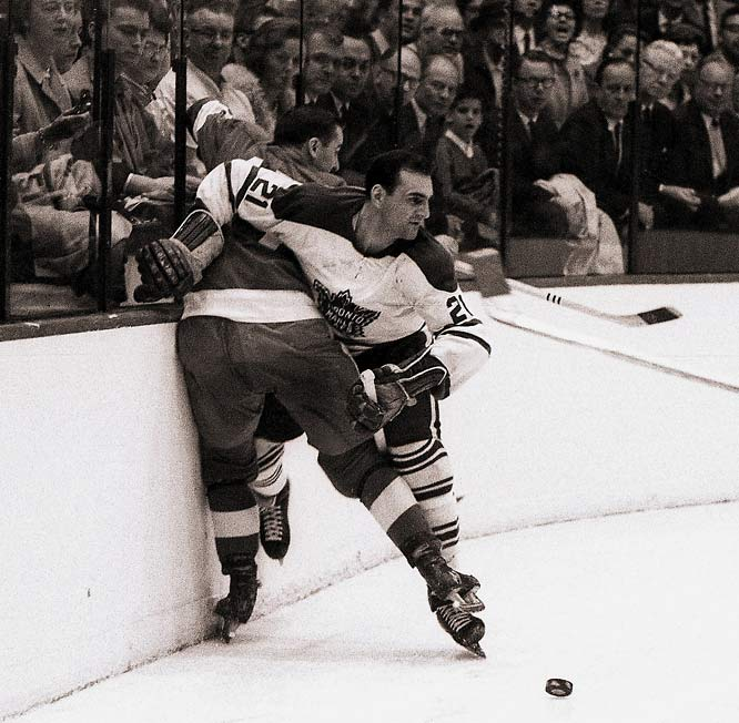 Taken off on a stretcher in the third period of Game 6 of the 1964 Stanley Cup Final, the defenseman returned to the ice early in the first overtime and to net the game-winning goal two minutes into the extra frame. A postgame X-ray revealed a broken bone in Baun's lower right leg, but even that didn't deter the hard-hitting blueliner. He took one shift in Game 7, which the Leafs won 4-0 for their third-consecutive championship. For more on Bobby Baun and other epic injury tales, read Stu Hackel's story on the NHL's timeless tradition of pain.