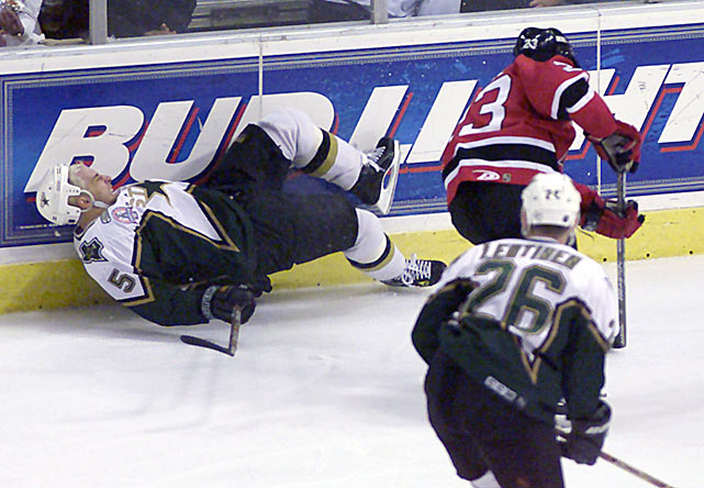 During Game 6 of the Stanley Cup Final, the Dallas Stars' defenseman collided with New Jersey's Scott Gomez and fell awkwardly into the boards, injuring his knee. In agony and unable to rise, Sydor gamely crawled and dragged himself across the ice and back into the play. (You can watch the play here.) Despite his heroics, the defending champion Stars lost the game, which clinched the Cup for the Devils.