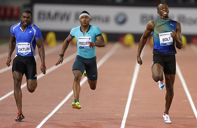 Justin Gatlin (left) beat world record-holder Usain Bolt (right) by one-hundredth of a second to win the 100 meters at the Golden Gala.