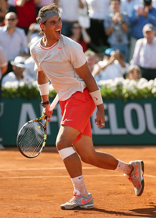 Nadal celebrates match point in his victory over Novak Djokovic in a semifinal of the French Open.