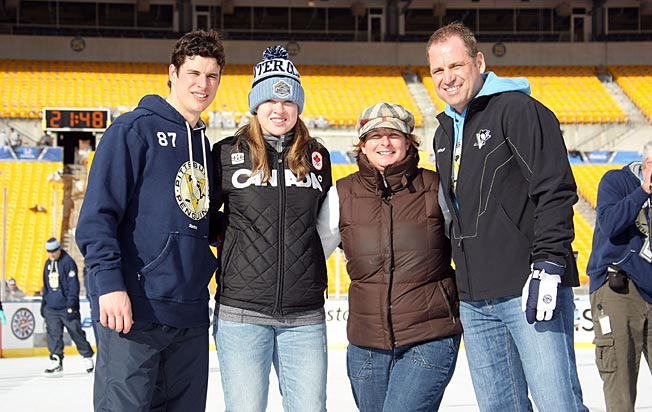 The Crosby family: Sidney started shooting pucks at his sister Taylor (second from left) three years ago.