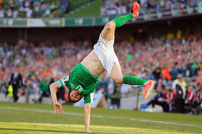 Keane celebrates after scoring one of his three goals against the Faroe Islands on Friday.