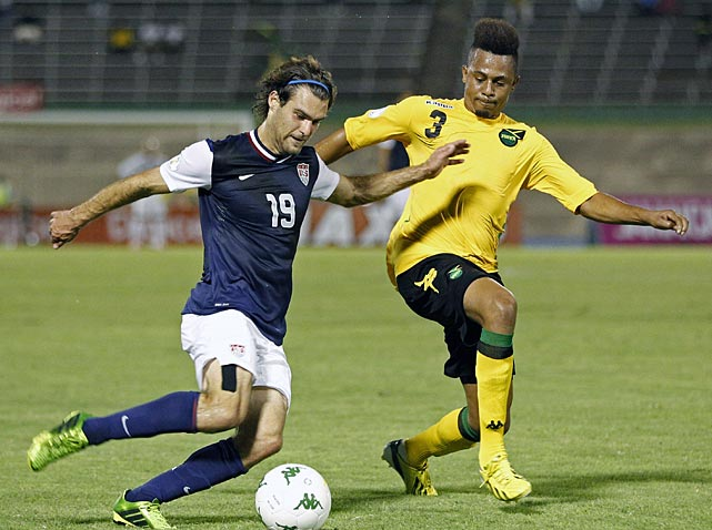 Graham Zusi is challenged by Jamaica's O'Brian Woodbine before passing the ball to teammate Jozy Altidore, unseen, who scored.