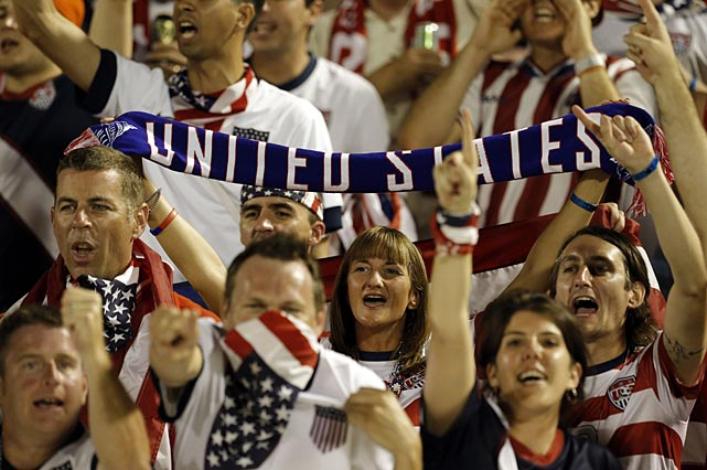 U.S. soccer fans cheer before the start of the 2014 World Cup qualifying soccer match between Jamaica and the United States in Kingston.