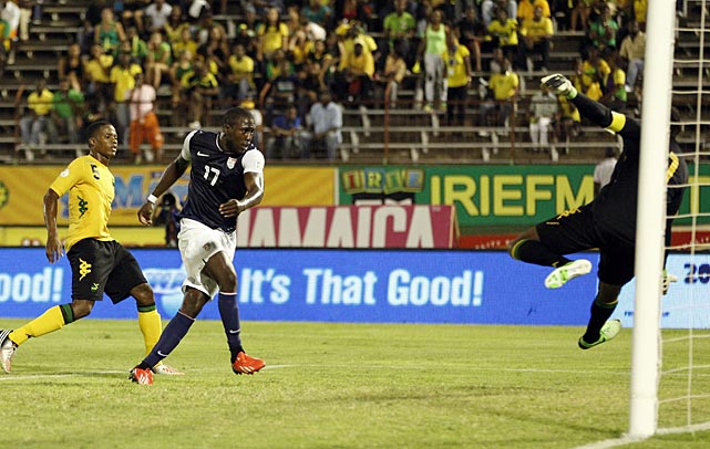 Jamaica's goalkeeper Donovan Ricketts, right, fails to block a shot by Jozy Altidore as Jamaica's Alvas Powell looks on in the first half.