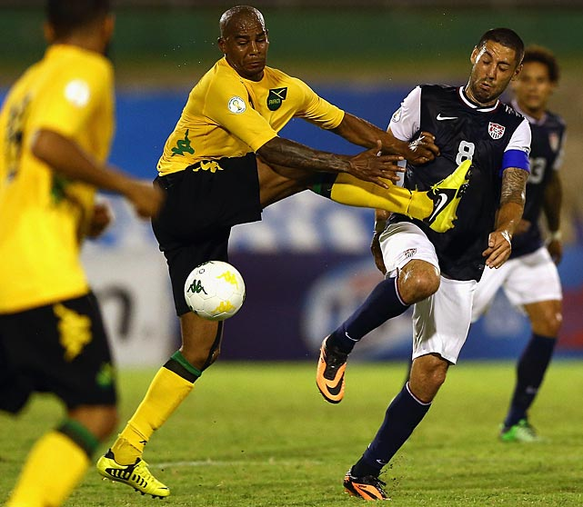 Marvin Elliot of Jamaica battles for a ball with Clint Dempsey.