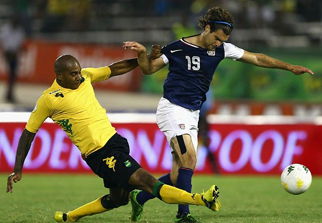 Marvin Elliot of Jamaica battles for a ball with Graham Zusi of the U.S.