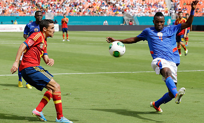 Donald Guerrier (right) scored a historic goal for Haiti in their loss to Spain in an international friendly.