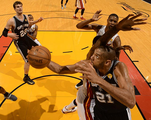 Duncan goes up and under an unidentified Miami defender.