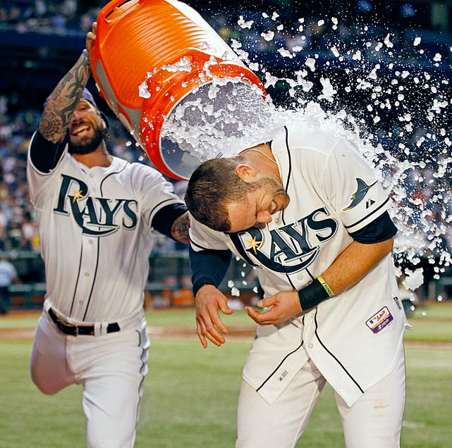 Evan Longoria is doused by teammate Ryan Roberts following the Rays 8-7 win over the Padres. Longoria had hit a two-run walk-off home run in the ninth inning.