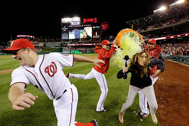 Jordan Zimmermann avoids being doused by teammates Drew Storen and Ryan Mattheus as sideline reporter Julie Alexandria takes the brunt of it following the Nationals 1-0 win over the Reds. Zimmermann threw a one hit complete game shutout.