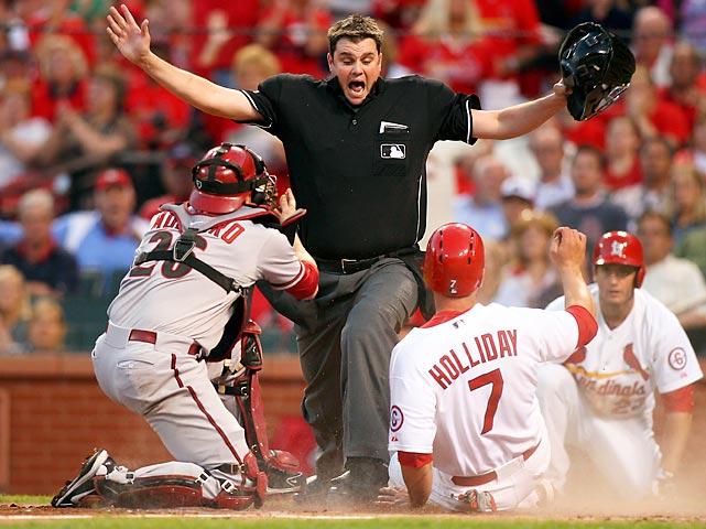 Jordan Baker calls Matt Holliday of St. Louis safe in a game the Cardinals won 7-1 on June 3 in Missouri.