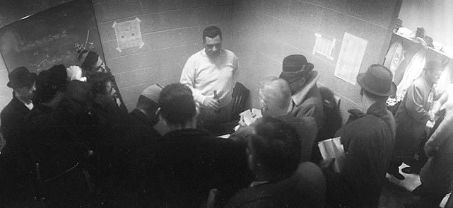 Lombardi answers reporters' questions in the locker room after defeating the New York Giants ? his former team ? in the 1961 NFL Championship. Before coming to Green Bay, Lombardi was an assistant with New York.