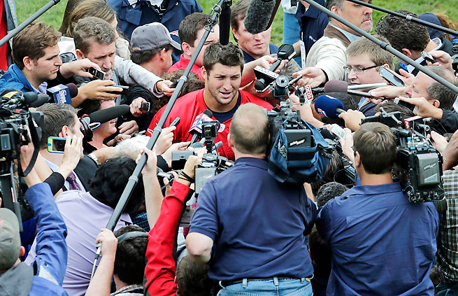 The circus has followed Tim Tebow all the way to Foxboro as he reports to Patriots minicamp.