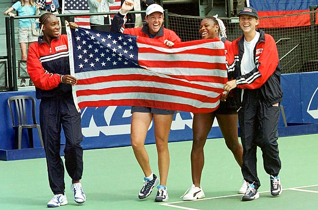 The Williams sisters, Lindsay Davenport and Monica Seles celebrate a Fed Cup win in 1999.