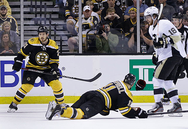 Patrice Bergeron converts Brad Marchand's centering pass into a game-winning goal at 15:19 of double overtime to give Boston a 2-1 victory in Game 3 of its Eastern final series against the heavily favored Penguins. The win puts Boston up three games to none and spells the beginning of the end for Pittsburgh. Tuukka Rask makes an astounding 53 saves and Boston forward Gregory Campbell (on the ice) wins courage points for finishing his shift after breaking his leg while blocking a slap shot from Evgeni Malkin.