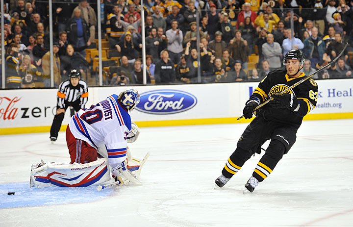 On Feb. 12, the Bruins lose to the Rangers on home ice, 4-3, in a shootout. The game features a remarkable ending in which Boston rallies from a three-goal deficit, getting a goal from David Krejci with 11:16 to play and then two late tallies after goaltender Tuukka Rask is on the bench: one from Nathan Horton at 18:29 and another from Brad Marchand at 19:17. Gee, that kind of comeback could never happen in a playoff game, huh?