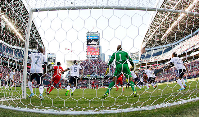 U.S. goalkeeper Tim Howard defends his net.