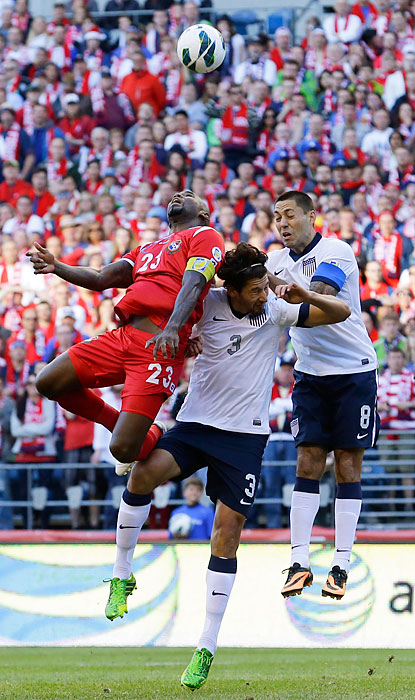 Clint Dempsey (right) and Omar Gonzalez (center) fight for a header with Panama's Felipe Baloy.