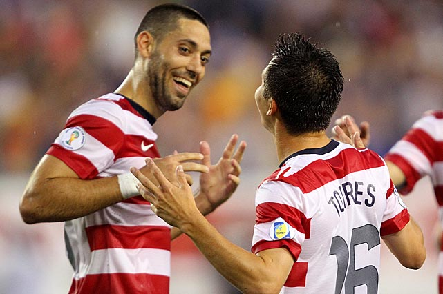 Dempsey celebrates his goal with Jose Francisco Torres as the United States defeated Antigua and Barbuda, 3-1, in a COCACAF semifinal round World Cup Qualifier.