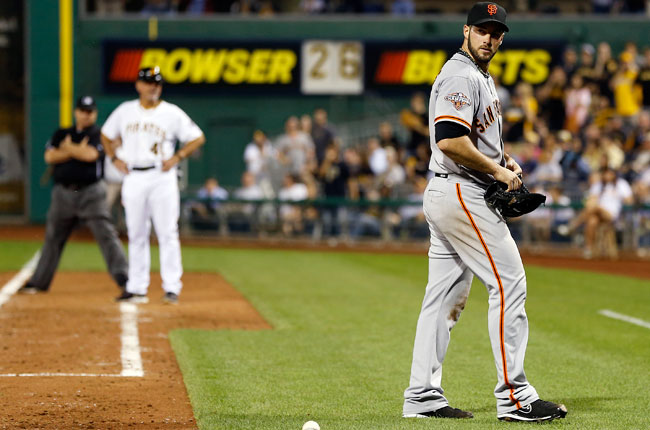 George Kontos looks back towards home plate after being ejected for hitting Andrew McCutchen.