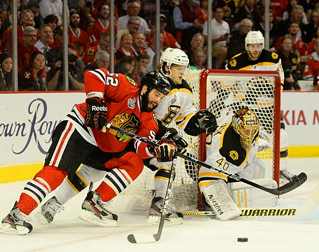 Chicago winger Brandon Bollig, who was inserted into the lineup in place of Viktor Stalberg to give the Blackhawks additional physicality, fights for position in front of the net. It was Bollig's first playoff action since his appearance in three first-round games vs. Minnesota.