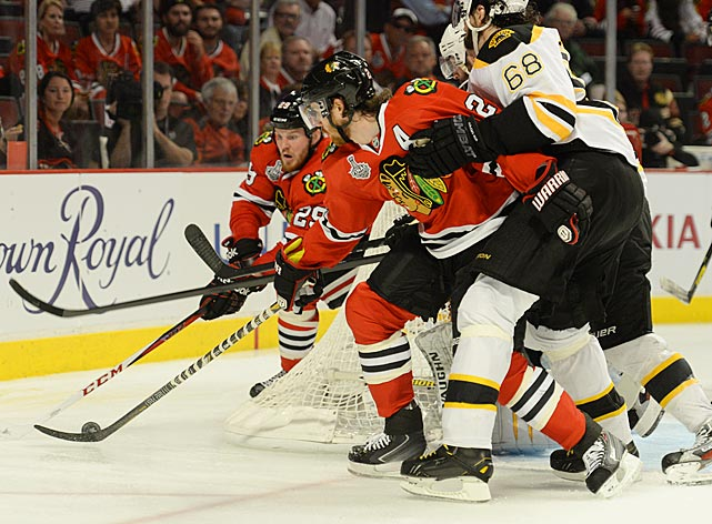 Boston's Jaromir Jagr (right) battles Chicago's Duncan Keith (center) and Bryan Bickell. Jagr was making his first championship series appearance in 21 years and nearly won the game for Boston in the second overtime when he deflected a shot by Zdeno Chara, but the puck hit the post.