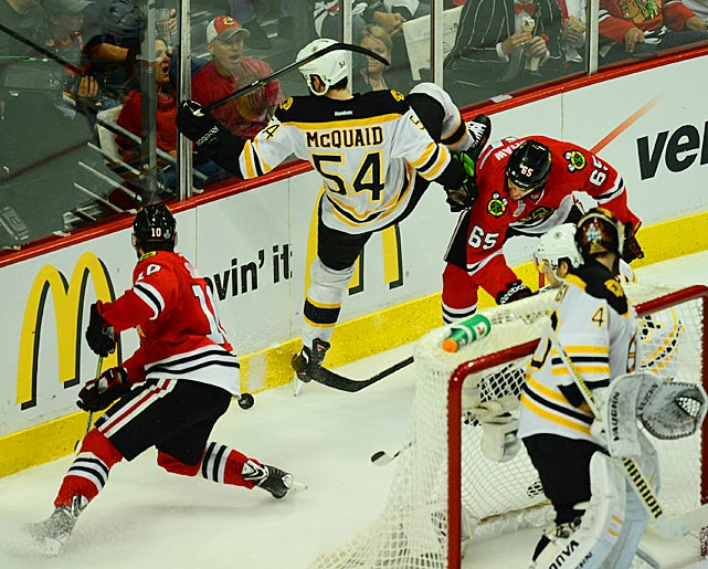 Andrew Shaw (right) upends Boston's Adam McQuaid.