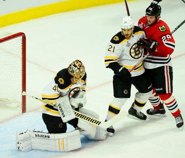 "Rask covers up a Blackhawks shot. ""We had the game,"" he later said. ""We're up 3-1 in the third and then a terrible turnover leads to a second goal and then a tough bounce leads to the tying goal, and we just gave it away."""