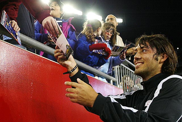 Dempsey signs autographs before a game against the Columbus Crew at Gillette Stadium.
