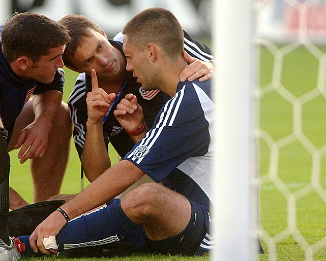 "Dempsey is asked ""How Many Fingers Do You See?"" by the team trainer after he was involved in a collision in the first-half of the 2005 MLS Cup in Frisco, Texas."