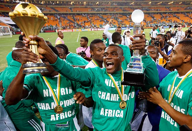 Nigeria's Emmanuel Emenike holds the trophy after Nigeria won the African Cup of Nations in February.