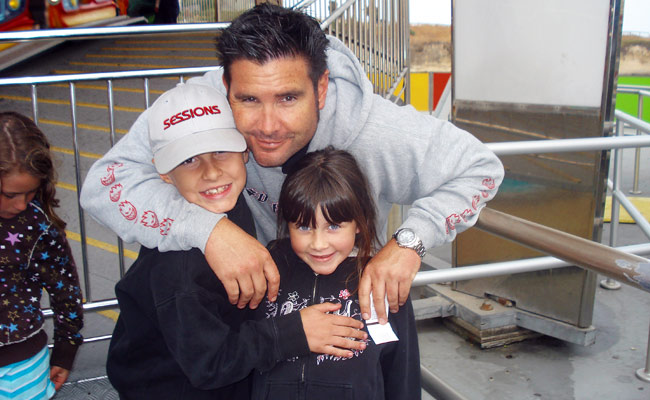 Bryan Stow, pictured here with his children prior to the 2011 attack, returned home on Wednesday.
