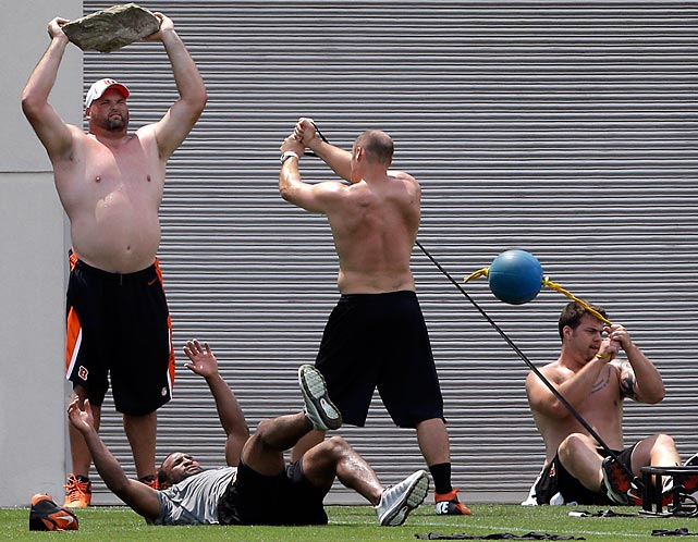 Everybody must get stoned: Bengals offensive tackle Andrew Whitworth (left) rocks out with teammates in Cincinnati.