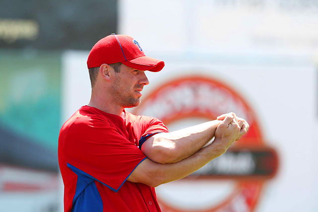 Lee stretches before a spring training game in Dunedin, Fla.