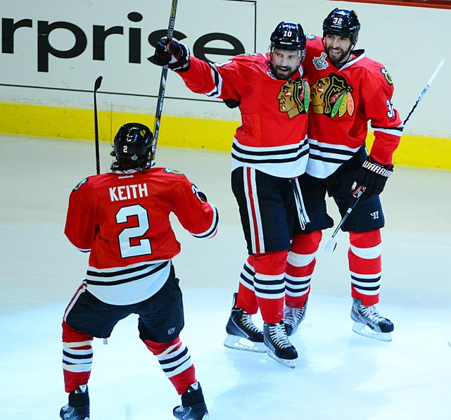 The Blackhawks celebrate Patrick Sharp's 1st period goal that gives them a 1-0 lead.