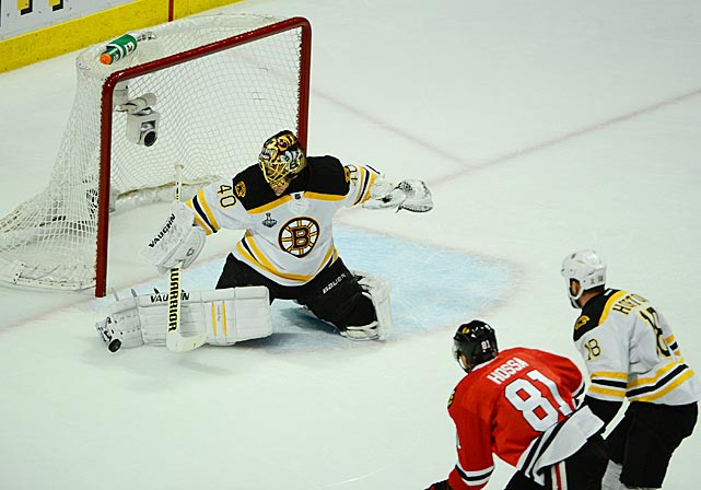 Tuukka Rask makes one of his 33 saves for the Bruins during Game 2.