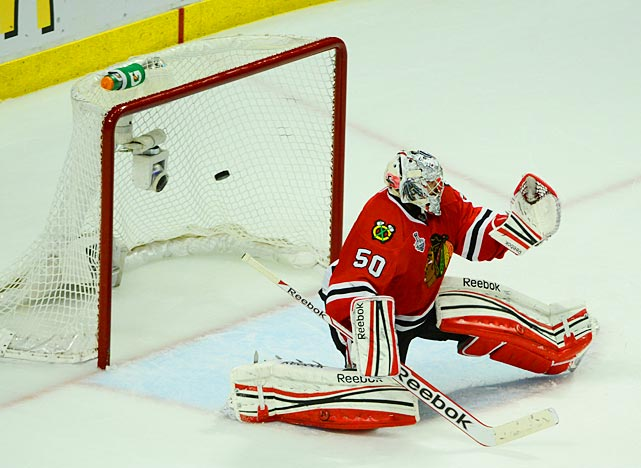 Corey Crawford gives up the game-winning goal in overtime to Daniel Paille.