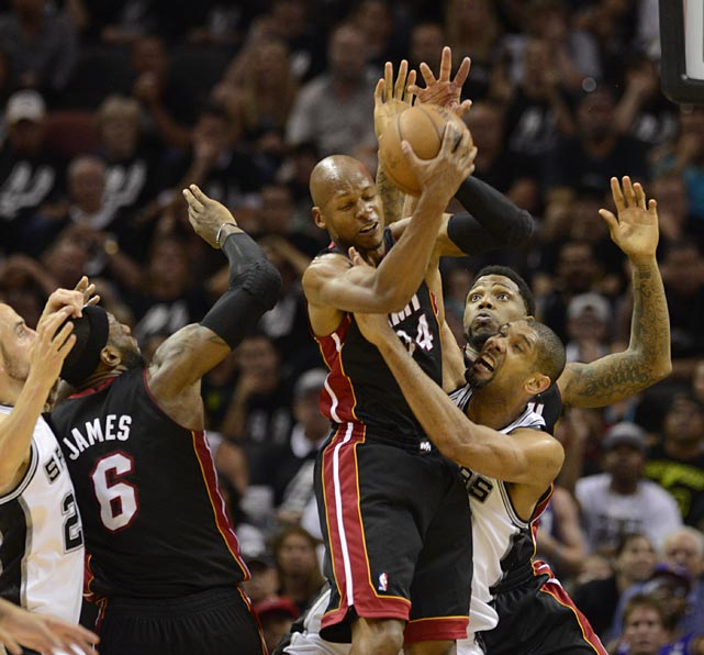 Ray Allen fights for a rebound against Duncan. Allen scored 21 points and became the first player in Finals history to convert two four-point plays in a single game.