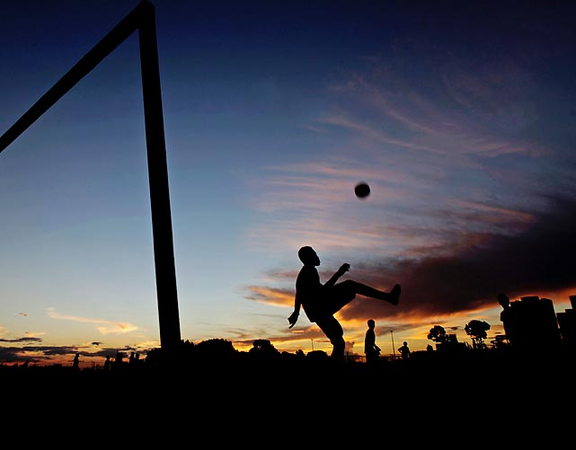 A boy kicks a soccer ball in the Ceilandia neighborhood in Brasilia, Brazil. The 2014 World Cup will be held in Brazil next year, from June 12 to July 13.