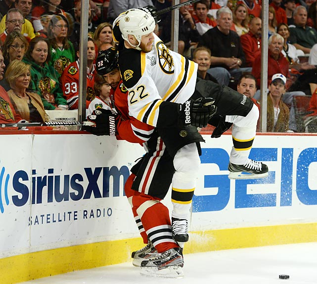 The Bruins' Shawn Thornton checks Michal Rozsival of the Blackhawks during Game 2 of the Stanley Cup Finals in Chicago. Boston won in overtime, 2-1, on a goal from Daniel Paille to even the series at 1-1.